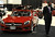 DENVER, CO- MARCH 19: Terrell Travis stands guard over the 2013 SL 550 Roadster Mercedes-Benz on the floor of the Denver Auto Show.  The Denver Auto Show is scheduled to opens Wednesday so preparation for the show is in full swing on March 19, 2013.  The show, which is at the Denver Convention Center, will run through the weekend.  The auto industry is putting renewed emphasis on natural gas-powered vehicles. The low prices of natural gas makes them an attractive option, especially for fleet operators. But a dearth of fueling stations. Also of interest at the show is the new prevalence of luxury cars such as Mercedes offering  