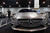 DENVER, CO- MARCH 19: Terrell Travis stands guard over the all new 2014 CLA 250 Mercedes-Benz.  The MSRP is $29,900 and will be available September 2013. The Denver Auto Show is scheduled to opens Wednesday so preparation for the show is in full swing on March 19, 2013.  The show, which is at the Denver Convention Center, will run through the weekend.  The auto industry is putting renewed emphasis on natural gas-powered vehicles. The low prices of natural gas makes them an attractive option, especially for fleet operators. But a dearth of fueling stations. Also of interest at the show is the new prevalence of luxury cars such as Mercedes offering  
