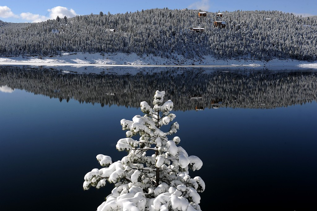 Description of . NEDERLAND, CO - MAY 2: Barker Reservoir reflects the 14 inches of fresh snow the town got from the recent storm on May 2, 2103.  Temperatures are expected to get into the 60's by the weekend for more springlike weather. (Photo by Helen H. Richardson/The Denver Post)