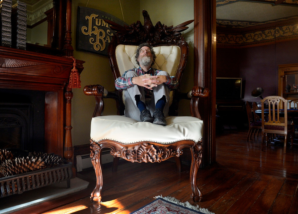Description of . DENVER, CO. - NOVEMBER 20: Denver historian Phil Goodstein poses for a portrait in a throne at the Lumber Baron Inn in  Denver, CO November 20, 2013. Goodstein has two new books, one is