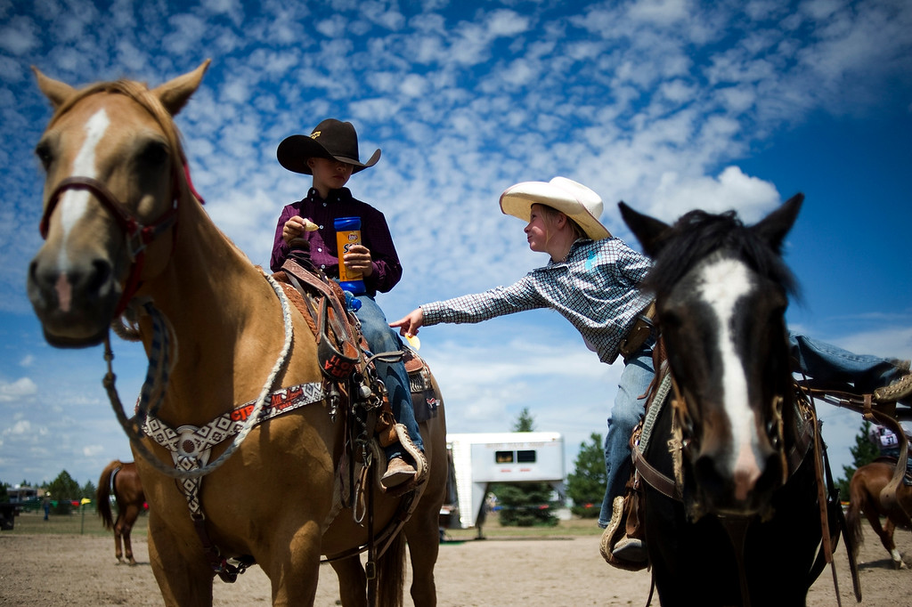 Description of . BURLINGTON, CO - AUGUST 09, 2013: Teagen Binder, 6, pokes Oakley Walters while he eats a stack of chips before the two compete in the flags competition at the rodeo in Burlington, Co.  (Photo By Grant Hindsley/The Denver Post)