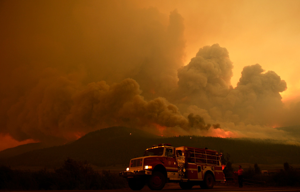 Description of . CREEDE, CO-June 27, 2013: Fire burns out of control at the Papoose Fire, June 27, 2013. The wildfire in southwestern Colorado continues to have potential for growth. (Photo By RJ Sangosti/The Denver Post)