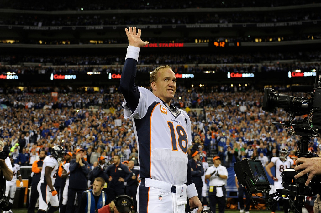 Description of . INDIANAPOLIS, IN. - October 20: Quarterback Peyton Manning (18) of the Denver Broncos acknowledges the crowd before his game vs the Indianapolis Colts at Lucas Oil Stadium. October 20, 2013 Indianapolis, Indiana. (Photo By Joe Amon/The Denver Post)