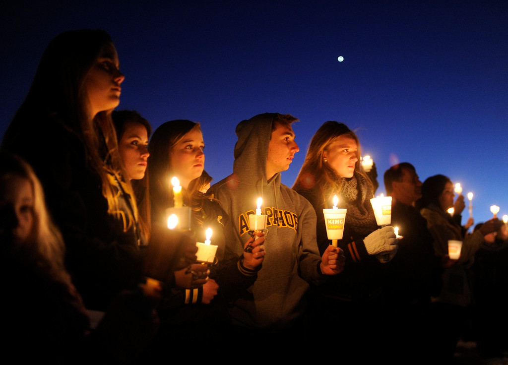 Description of . CENTENNIAL, CO. - DECEMBER 14: Hundreds of Arapahoe High School students gathered for a candlelight vigil Saturday night to share their prayers for Claire Davis who was shot inside the school Friday, December 13, 2013. The vigil was held at Arapaho Park in Centennial, not far from the school. Photo By Karl Gehring/The Denver Post