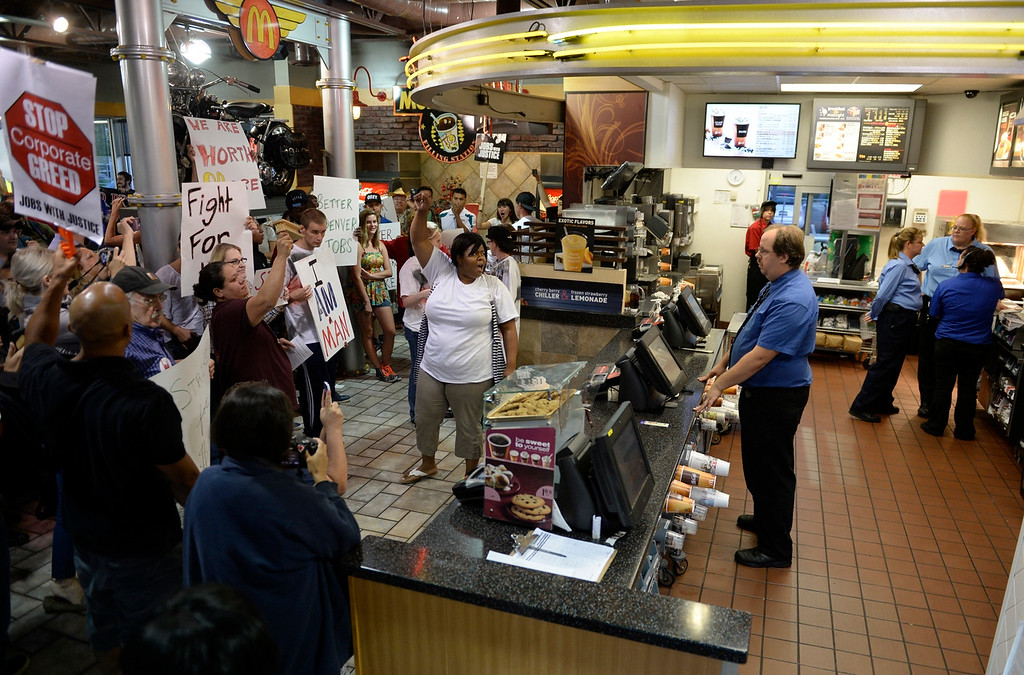 Description of . NORTHGLENN, CO-August, 2013: Protesters, asking for better wages for fast food workers, take over a McDonald's in Northglenn, August 29, 2013. They are asking for $15 an hour for workers in this nationally organized event. (Photo By RJ Sangosti/The Denver Post)