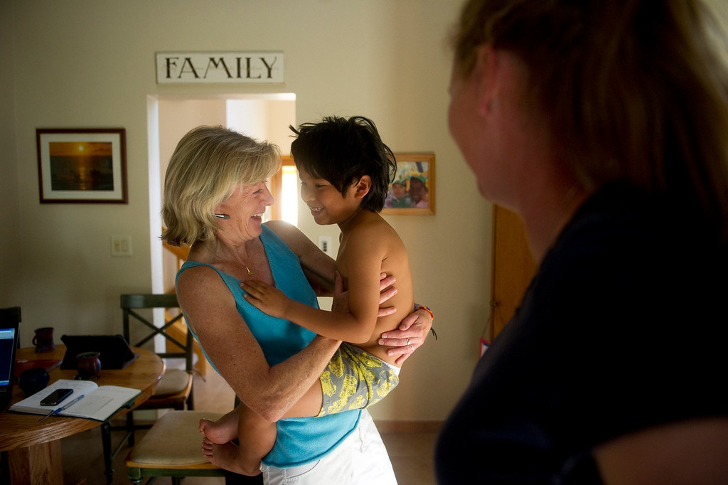 Description of . BOULDER, CO. - JUNE 26 Catriona Dowling holding her son Cian, 6, and Cathy Davis celebrate after learning that the Defense of Marriage Act has been struck-down, at their home on June 26, 2013.  (Photo By Grant Hindsley/The Denver Post)
