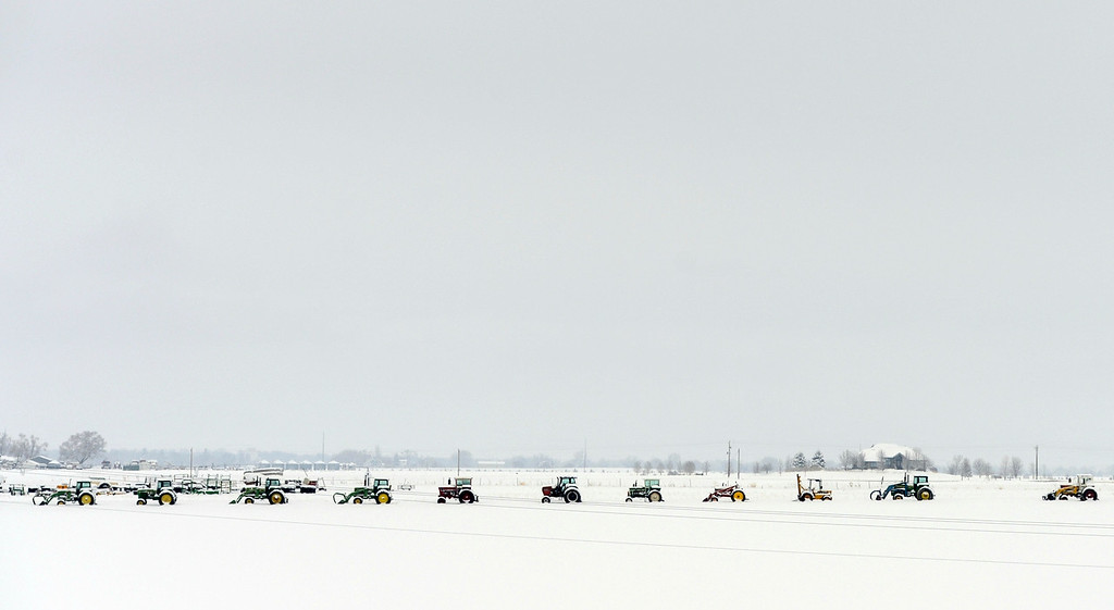 Description of . BERTHOUD, CO-April 16, 2013: Farm equipment is lined up in a field near Berthoud, April 16, 2013. A spring snow storm hit northern Colorado covering the field in fresh snow. (Photo By RJ Sangosti/The Denver Post)