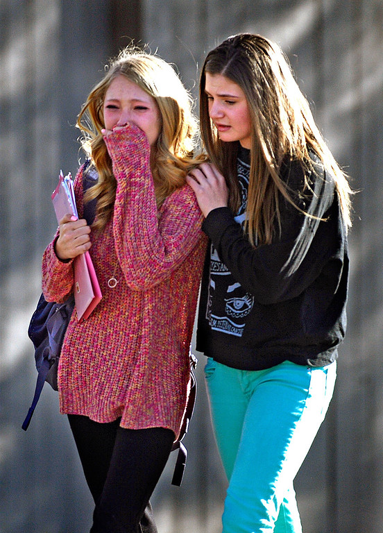 Description of . CENTENNIAL, CO - DECEMBER 13: Students and parents leave Arapahoe High School after a gunman opened fire at the school, December 13, 2013. One student was critically wounded. (Photo by RJ Sangosti/The Denver Post)