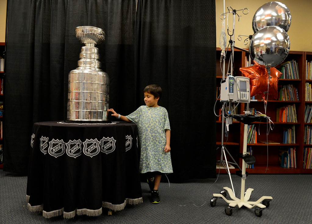 Description of . DENVER, CO. - MAY 15: Miguel Calihua-Gonzales, 6, gets up close and personal with the Stanley Cup at Rocky Mountain Hospital for Children in Denver, CO May 15, 2013. Miguel, of Minatare, NE, is a patient at the hospital being treated for Hodgkin's lymphoma. The hospital, Make-A-Wish, Discover and the National Hockey League teamed up to grant the wish of Logan Piz, 13, to spend a day with the Stanley Cup and share it with friends, family and supporters. Logan has not played hockey since he was diagnosed with Ewing's sarcoma in November 2012. (Photo By Craig F. Walker/The Denver Post)