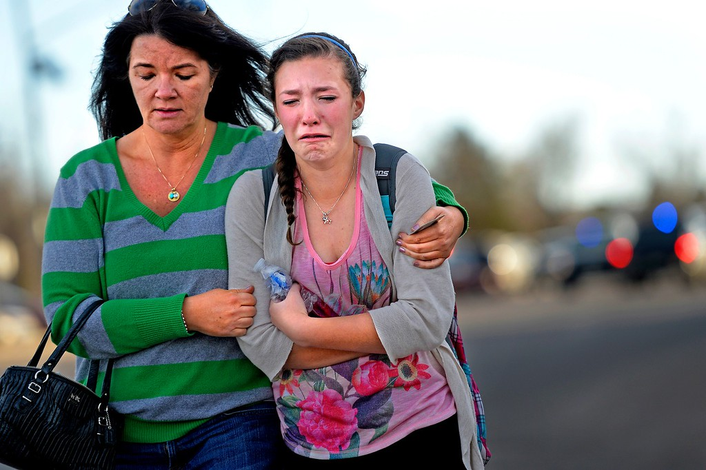 Description of . CENTENNIAL, CO. - December 13: Meredith Strecker comforts her daughter Madisen after being reunited outside the  Shepherd of the Hills church in Centennial, CO December 13, 2013. Madisen is a freshman at the school where a student carried a shotgun into Arapahoe High School and opened fire on Friday, wounding two fellow students before apparently killing himself December 13, 2013 Centennial, CO. (Photo By Joe Amon/The Denver Post)