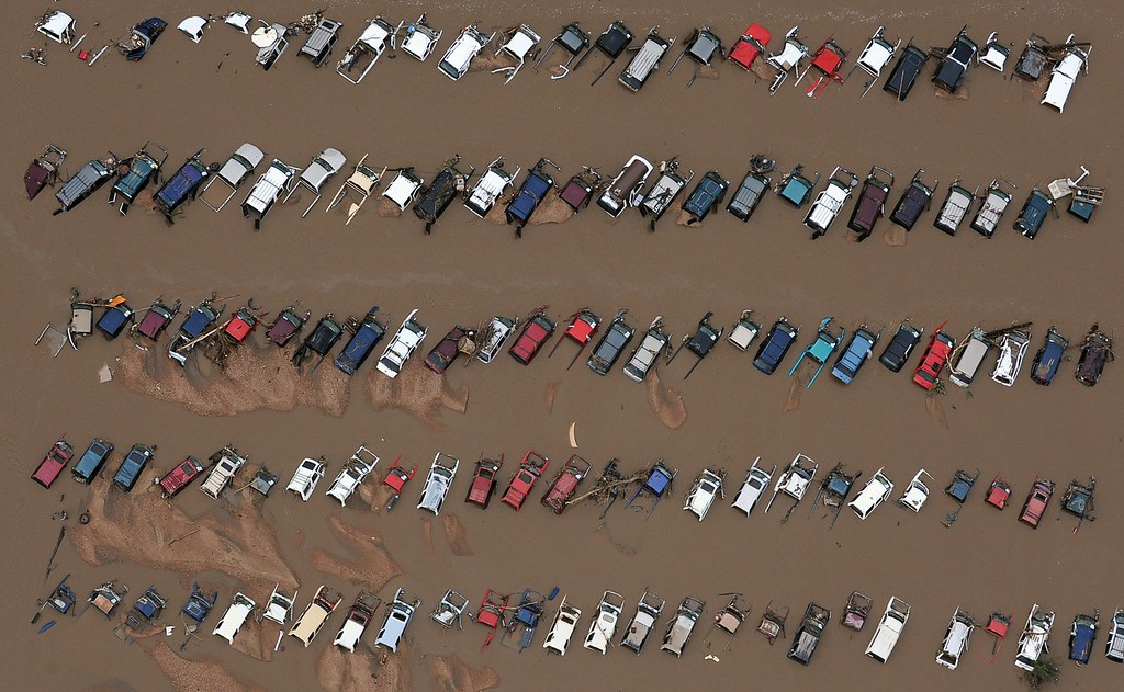 Description of . EVANS, CO. - SEPTEMBER 16:  Cars in a Junk yard on 37th street in Evans Colorado. Aerial photographs of the Platte River flooding cities and farms in Weld County Colorado. (Photo By Tim Rasmussen/The Denver Post)