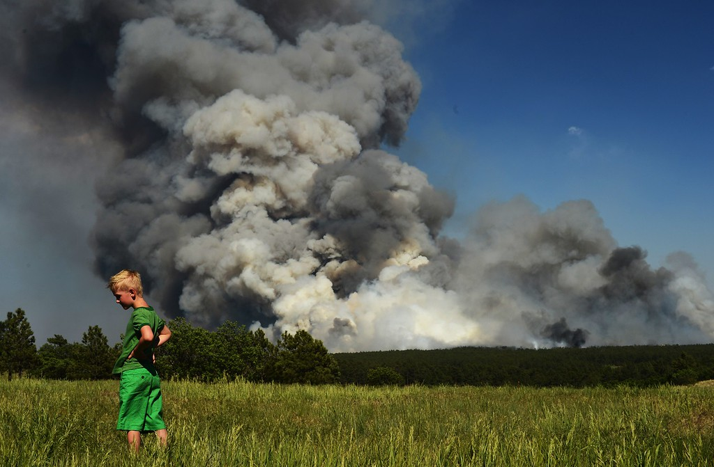 Description of . Colorado Springs, CO. - June 11: Floyd Kerr Jr., 7, of Colorado Springs is watching the smoke cover BLack Forest area. Colorado Springs, Colorado. June 8, 2013. The fire is about 15 acres near the 12600 block of Peregrine Way near Black Forest Regional Park. (Photo By Hyoung Chang/The Denver Post)