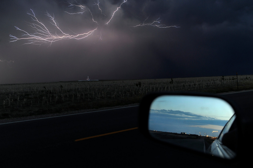 Description of . DENVER, CO. - AUGUST 10: Lightning illuminated the night in the skies south of Denver International Airport Saturday night, August 10, 2013. Photo By Karl Gehring/The Denver Post