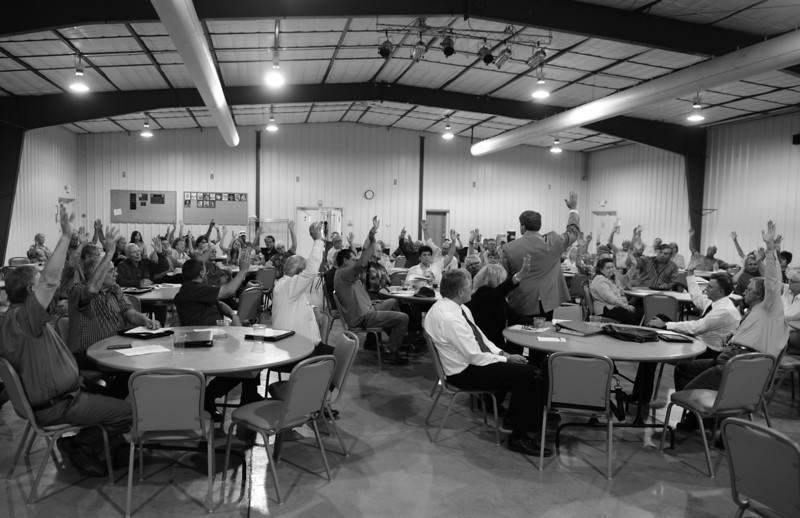 Description of  AKRON, CO-July 08, 2013: Almost everyone in the room at the Washington County fairgrounds in Akron, CO, raised their hands when asked if they felt if their needs were being ignored by the Colorado State Legislature during a public meeting to talk about the idea of forming the 51st state, July 08, 2013. The proposal came after many attending the meeting felt that the State Legislature continued to ignore the needs of rural Colorado. (Photo By RJ Sangosti/The Denver Post)