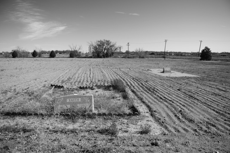 Description of  SUGAR CITY, CO - NOVEMBER 04: With little to no water, there is no grass around the headstones at the cemetery in Sugar City, CO, November 04, 2013. To keep down the dust, the topsoil as been plowed and turned over, which causes the cemetery to blend into the farmland behind it. (Photo By RJ Sangosti/The Denver Post)