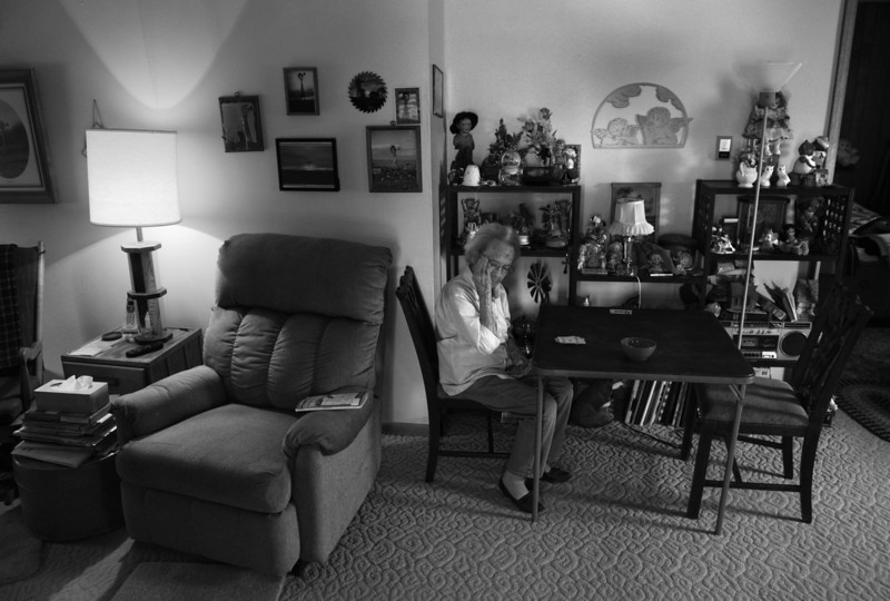 "Description of  KARVAL, CO - JUNE 23: On a hot summer day with temperatures in the mid 90s, Alice Webb, 96, of Karval, wipes sweat from her brow as she plays solitaire alone in her living room, June 23, 2013. ""I've lived through the Great Depression, the drought in the 1950s, but nothing compares to what I'm seeing now,"" said Webb."