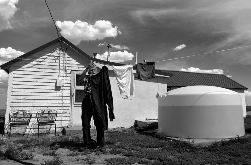 "Description of  EADS, CO - AUGUST 06: Bill Krum Sr. hangs laundry outside of his home in Eads, August 06, 2013. With water in short supply in the area due to a Stage 4 drought, Krum has put in an emergency water tank. ""We are old and live out in the middle of nowhere. Without water, it is scary to live out here. This just gives me and my wife a little peace of mind,"" said Krum."