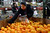 Elizabeth Ramirez and her daughter Jacqueline, 7, selects oranges in the Feeding Families shopping area at the Community Food Share in Longmont, CO, Thursday December 27, 2012.  Craig F. Walker, The Denver Post