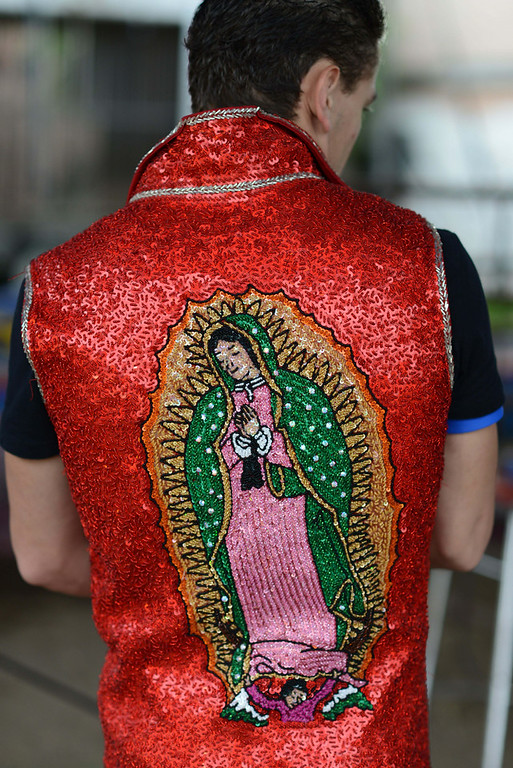 Description of . In this June 25, 2014, photo, Bebeto Fuentes, one of the performers with the Fuentes Gasca Brothers Circus, wears a vest with a sequined image of Our Lady of Guadalupe in Mexico City. Like many of the performers at the circus Fuentes performs in a variety of capacities including trapeze artist, clown, acrobatics and animal trainer. (AP Photo/Sean Havey)