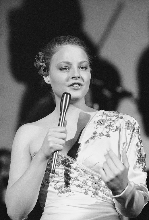 Description of . In this Feb. 13, 1982 file photo, actress Jodie Foster rehearses a song during filming of a television production
