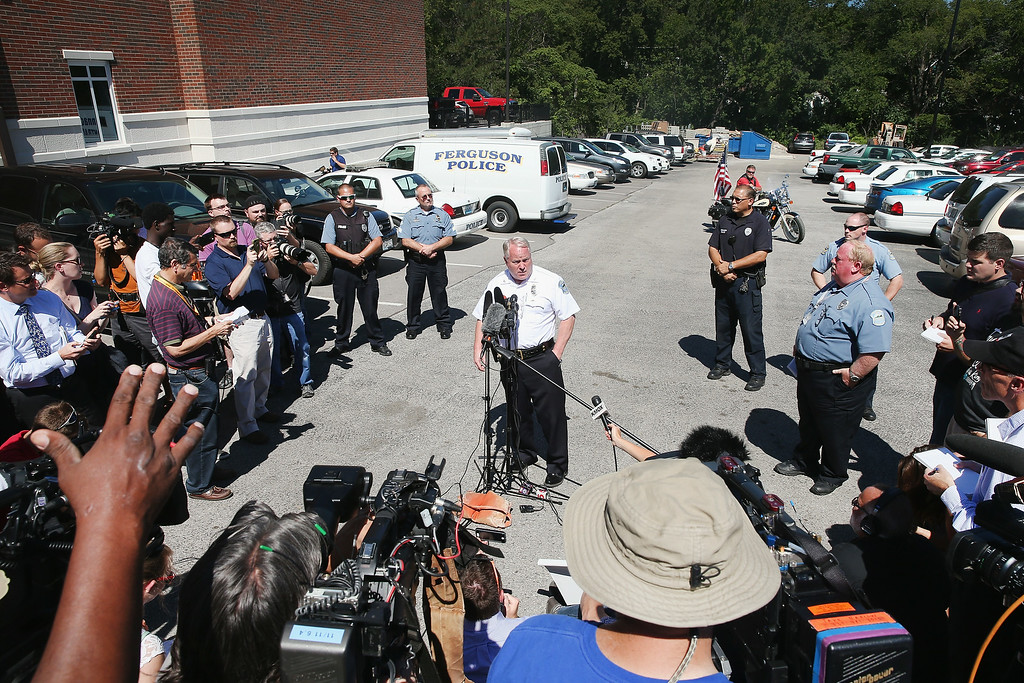 Description of . FERGUSON, MO - AUGUST 13:  Police Chief Thomas Jackson fields questions related to the shooting death of teenager Michael Brown during a press conference on August 13, 2014 in Ferguson, Missouri. Brown was shot and killed by a Ferguson police officer on Saturday. Ferguson has experienced three days of violent protests since the killing.  (Photo by Scott Olson/Getty Images)
