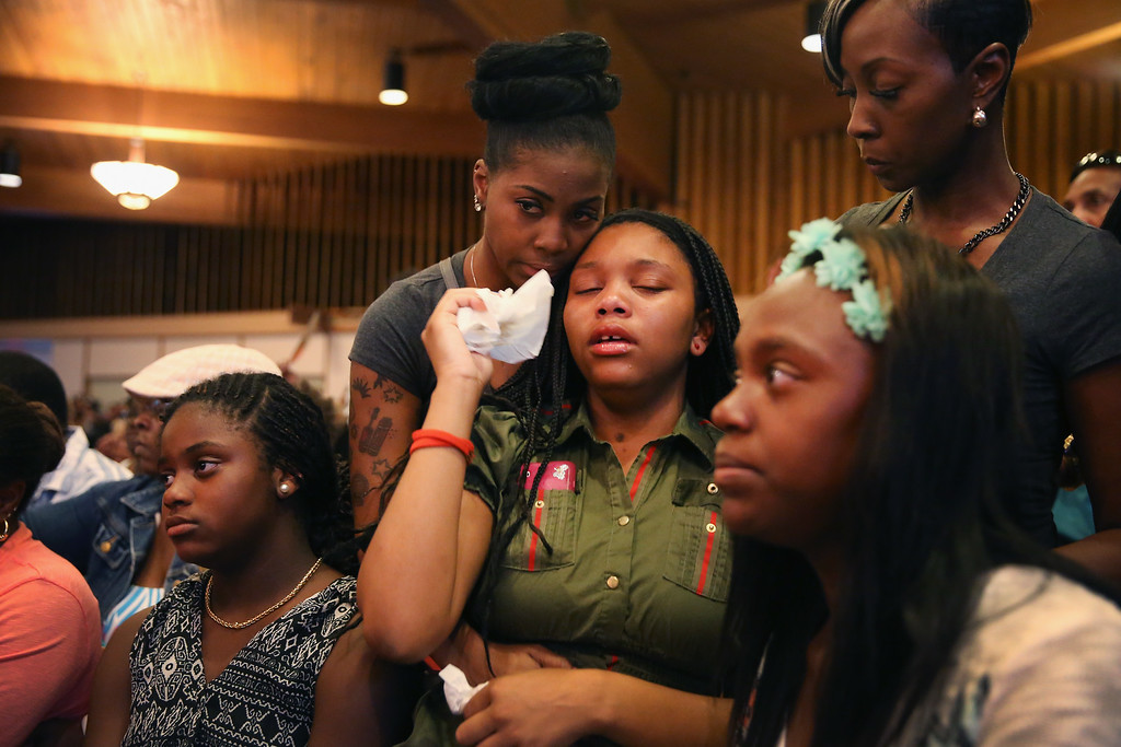Description of . ST. LOUIS, MO - AUGUST 12: A capacity crowd gathers at Greater St. Marks Family Church along with the family of Michael Brown and civil rights leader Rev. Al Sharpton to discuss the killing of Brown and the civil unrest resulting from his death on August 12, 2014 in St Louis, Missouri. Brown was shot and killed by a police officer on Saturday in the nearby suburb of Ferguson. Ferguson has experienced two days of violent protests since the killing but, tonight the town remained mostly peaceful.  (Photo by Scott Olson/Getty Images)