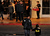 AURORA, CO - JANUARY 17: A youth wearing Batman logo shirts is escorted to the Century Aurora. The movie theater where a gunman killed 12 people and wounded dozens of others reopened with a private ceremony for victims, first responders and officials. (Photo By Hyoung Chang / The Denver Post)