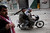 FILE - Free Syrian Army fighters ride a motorbike to approach Syrian Army tanks in Idlib, north Syria, Sunday, March 11, 2012. (AP Photo/Rodrigo Abd, File)