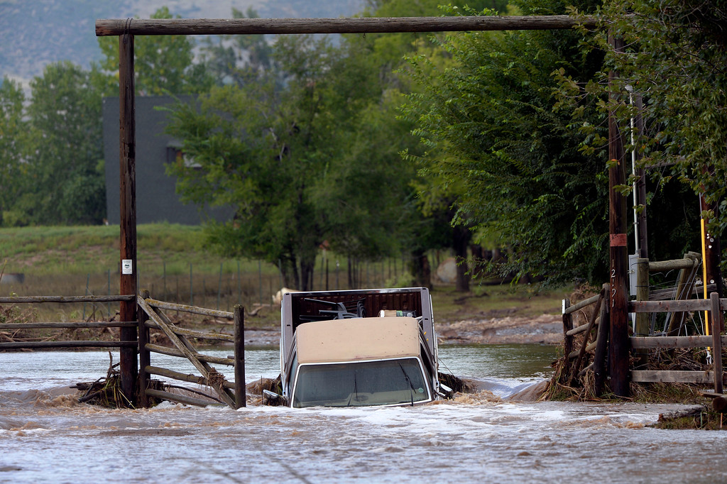 Description of . HYGIENE, CO. - SEPTEMBER 14: A truck rests flooded at the entrance to Ron Krenzel's property on 61st Street near Longmont, CO September 14, 2013.  (Photo By Craig F. Walker / The Denver Post)