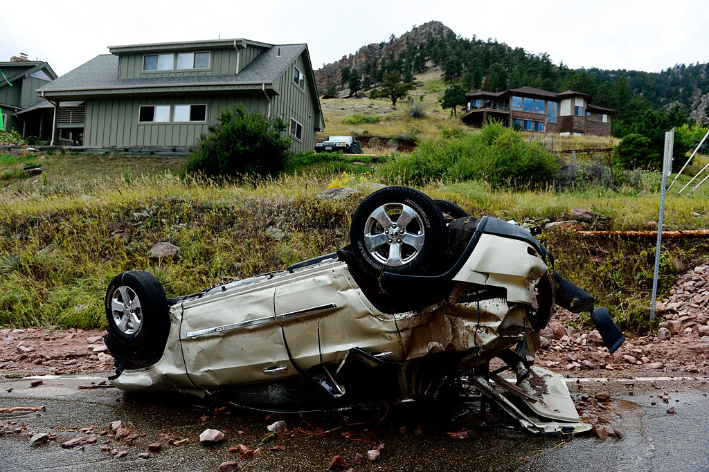 Description of . BOULDER, CO - SEPTEMBER 13: An overturned vehicle sits on Linden Road near S. Cedar Brook Rd. in Boulder Colorado on September 13, 2013. (Photo By Andy Cross/The Denver Post)