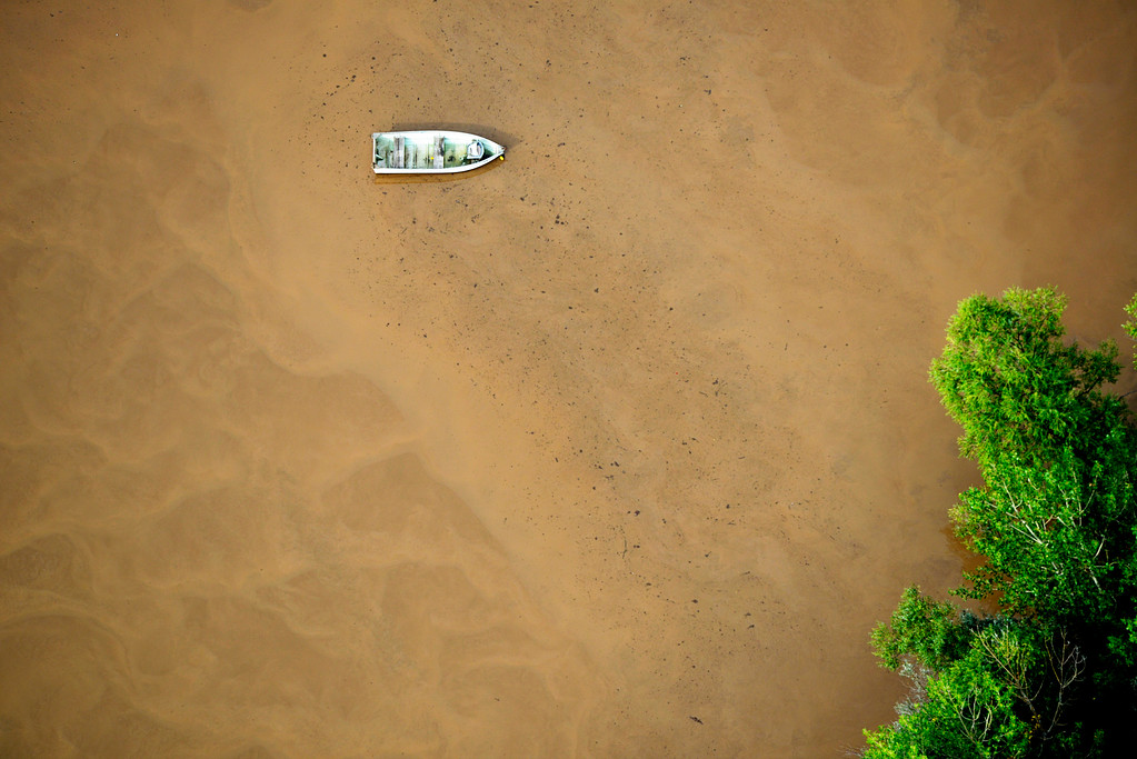Description of . LOVELAND, CO - SEPTEMBER 14: A fishing boat floats out in a flooded plain in Loveland, Colorado on September 14, 2013. (Photo By Andy Cross/The Denver Post)