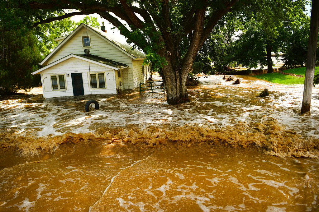Description of . HYGIENE, CO - SEPTEMBER 13: Flood waters have consumed a house along Hygiene Road east of North 61st street and west of Hygiene, Colo. on September 14, 2013. Massive flooding continues in 14 continues in Colorado.  (Photo By Helen H. Richardson/ The Denver Post)