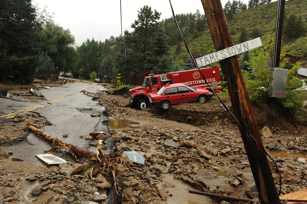 Description of . JAMESTOWN, CO - SEPTEMBER 15: An engine from Jamestown Fire Department and another car, are casualties of the flood in Jamestown, Colo. on September 15, 2013. The town has been completely destroyed from the recent floods. (Photo By Helen H. Richardson/ The Denver Post)