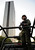 A soldier stands guard near the headquarters of state oil giant Pemex in Mexico City January 31, 2013. A powerful explosion rocked the Mexico City headquarters of state oil giant Pemex on Thursday, killing at least 14 people and injuring 100 others.   REUTERS/Alejandro Dias