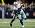Dallas Cowboys wide receiver Miles Austin (front) carries the ball as Philadelphia Eagles corner back Brandon Boykin tries to make the tackle first half of their NFL football game in Arlington, Texas December 2, 2012.  REUTERS/Mike Stone