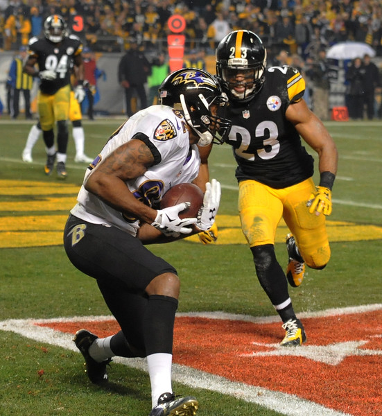 Baltimore Ravens wide receiver Torrey Smith (82) makes a touchdown catch past Pittsburgh Steelers free safety Mike Mitchell (23) in the third quarter of an NFL wildcard playoff football game, Saturday, Jan. 3, 2015, in Pittsburgh. (AP Photo/Don Wright)