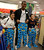 Broncos wide receivers Demaryius Thomas poses with cookie monster pajamas with Amanda (L) and Guadalupe Jose as they shop for their family. Broncos wide receivers Demaryius Thomas and Eric Decker, along with other teammates, reached out to help children in their community by hosting a holiday shopping trip at Super Target Tuesday, December 11, 2012 in Lone Tree. 25 children, ranging in age from 8 to 14, are being rewarded for their outstanding participation in their after-school program with a trip to buy holiday presents. John Leyba, The Denver Post