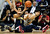 California guard Justin Cobb (1) picks up a loose ball in front of Colorado guard Sabatino Chen during the second half of their NCAA college basketball game in Boulder, Colo., Sunday, Jan. 27, 2013. Colorado won 81-71. (AP Photo/David Zalubowski)