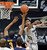 Xavier Johnson of CU tries to block the shot of Tyrone Wallace of Cal during the first half of the January 27th, 2013 game in Boulder.