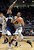 Spencer Dinwiddie of CU drives into Tyrone Wallace of Cal during the first half of the January 27th, 2013 game in Boulder.