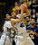 Colorado forward Josh Scott, center, pulls in a rebound in front of teammate Xavier Johnson, left, and California forward Richard Solomon in the first half of an NCAA basketball game in Boulder, Colo., Sunday, Jan. 27, 2013. (AP Photo/David Zalubowski)