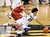 Sabatino Chen (23) slides in to take the ball away from Chass Bryan of USC during the second half of their Jan. 10, 2013 game in Boulder. (AP Photo/Daily Camera, Cliff Grassmick)