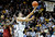 University of Colorado's Sabatino Chen goes for a layup over DeWayne Dedmon during a game against the University of Southern California on Thursday, Jan. 10, at the Coors Event Center on the CU campus in Boulder.  Jeremy Papasso/ Daily Camera