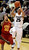 Spencer Dinwiddie of CU puts up a shot on J.T. Terrell of USC during the second half of the January 10, 2013 game in Boulder.    Cliff Grassmick/Daily Camera