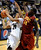 University of Colorado's Andre Roberson drives to the hoop past DeWayne Dedmon, No. 14, during a game against the University of Southern California on Thursday, Jan. 10, at the Coors Event Center on the CU campus in Boulder. Jeremy Papasso/Daily Camera