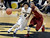 University of Colorado's Askia Booker drives past Chass Bryan during a game against the University of Southern California on Thursday, Jan. 10, at the Coors Event Center on the CU campus in Boulder. Jeremy Papasso/Daily Camera