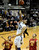 University of Colorado's Sabatino Chen goes for a layup over Chass Bryan, No. 13, and Aaron Fuller, No. 21, during a game against the University of Southern California on Thursday, Jan. 10, at the Coors Event Center on the CU campus in Boulder. Jeremy Papasso/Daily Camera