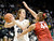 University of Colorado's Rachel Hargis looks to pass the ball over Joslyn Tinkle during a game against Stanford on Friday, Jan. 4, at the Coors Event Center on the CU campus in Boulder.    Jeremy Papasso/Camera