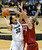 University of Colorado's Arielle Roberson takes a shot over Mikaela Ruef, right, during a game against Stanford on Friday, Jan. 4, at the Coors Event Center on the CU campus in Boulder.    Jeremy Papasso/Camera