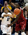 Colorado guard Ashley Wilson, left, passes ball under pressure by Stanford forward Chiney Ogwumike in the first half of an NCAA women's college basketball game in Boulder, Colo., on Friday, Jan. 4, 2013. (AP Photo/David Zalubowski)
